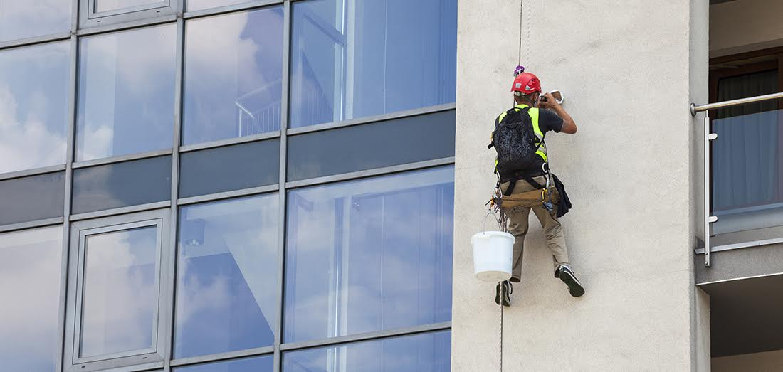 Building maintenance: Man working at height